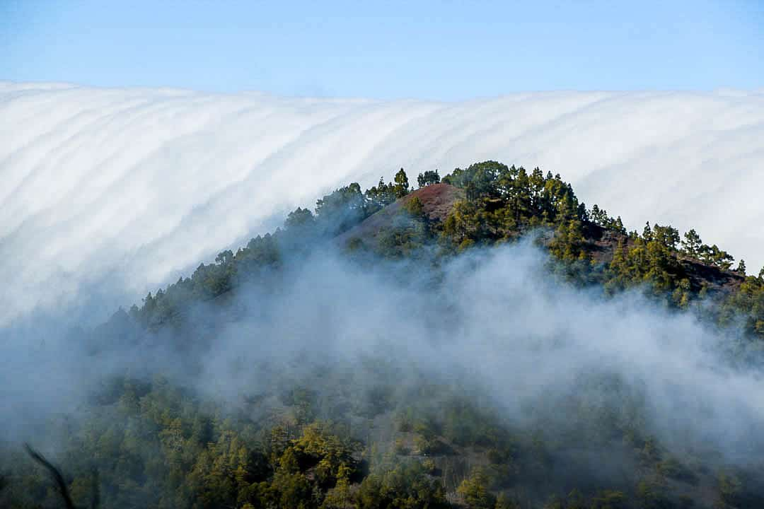 Cloud waterfall phenomenon in La Palma. La Palma - The Hidden Gem of the Canary Islands, article by Kiss My Backpack at https://www.kissmybackpack.com/