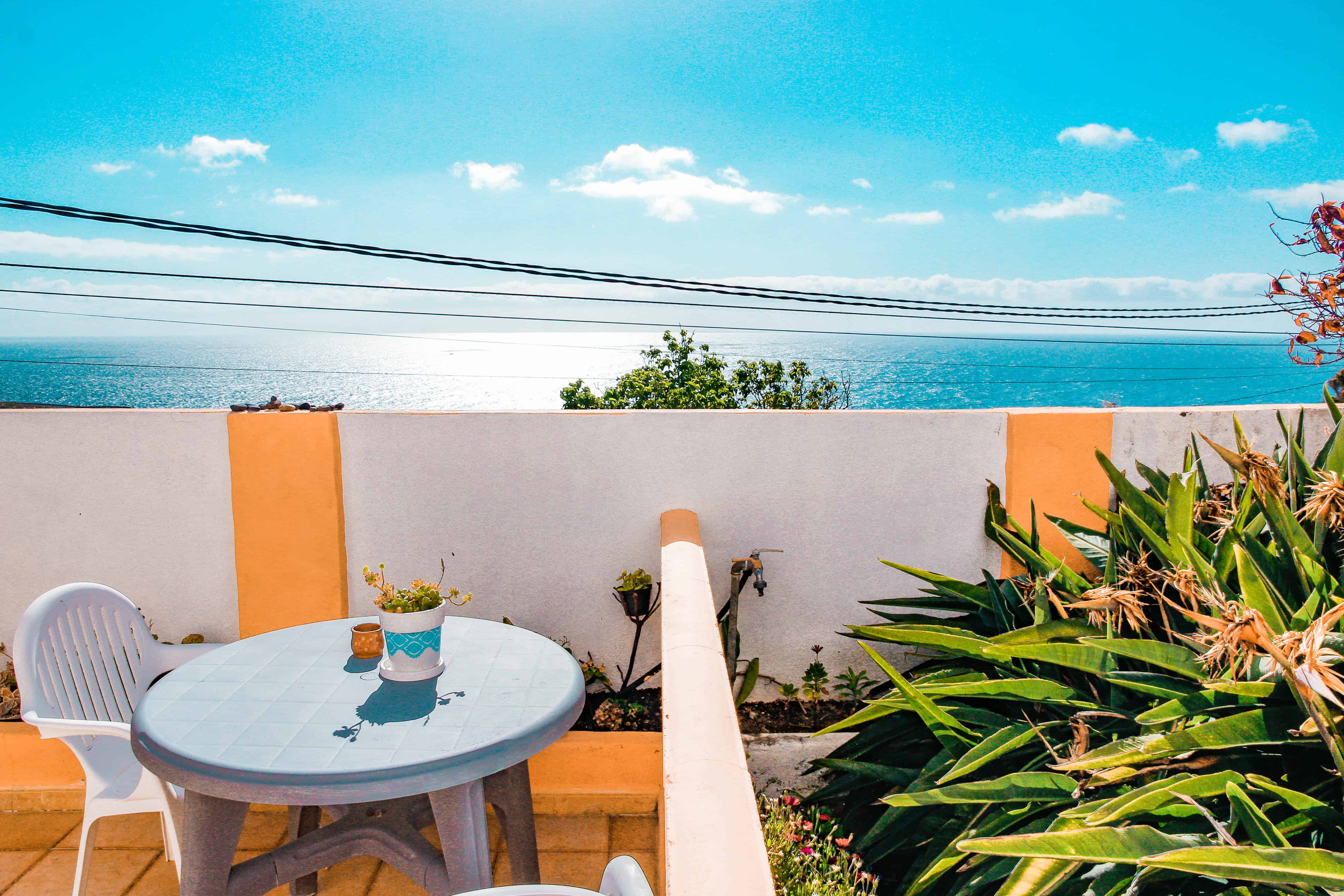 Morning breakfast spot with ocean view in La Palma, Canary Islands. Paradise home in La Palma, article by Kiss My Backpack at https://www.kissmybackpack.com/
