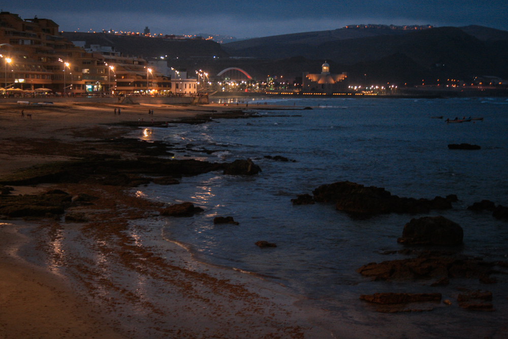 Cosy evening beach lights and soft waves