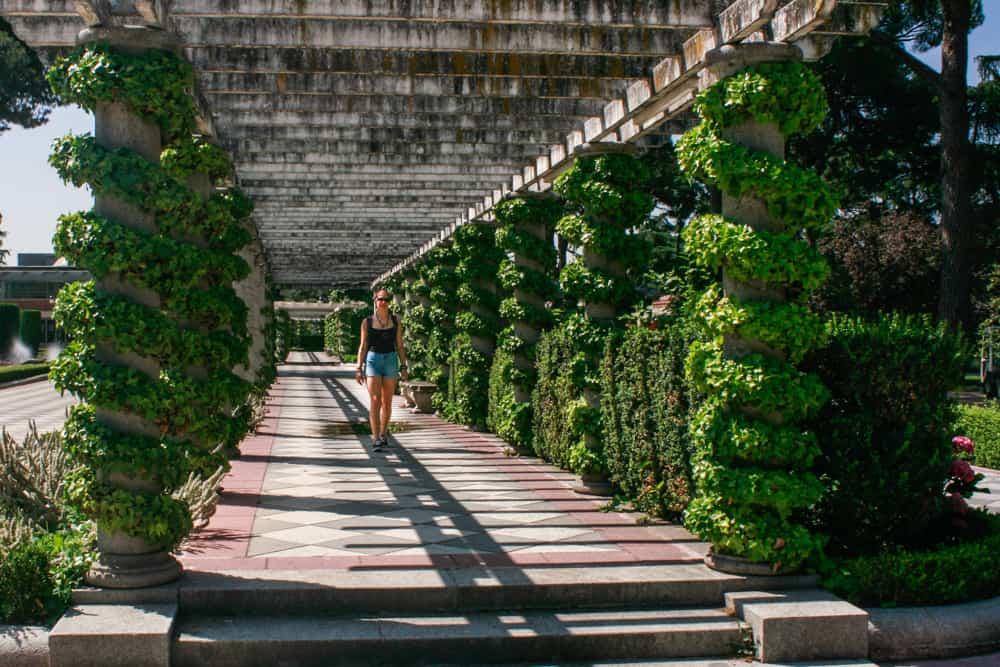 A travelling girl walking under the shadow in El Retiro Park, Madrid, Spain