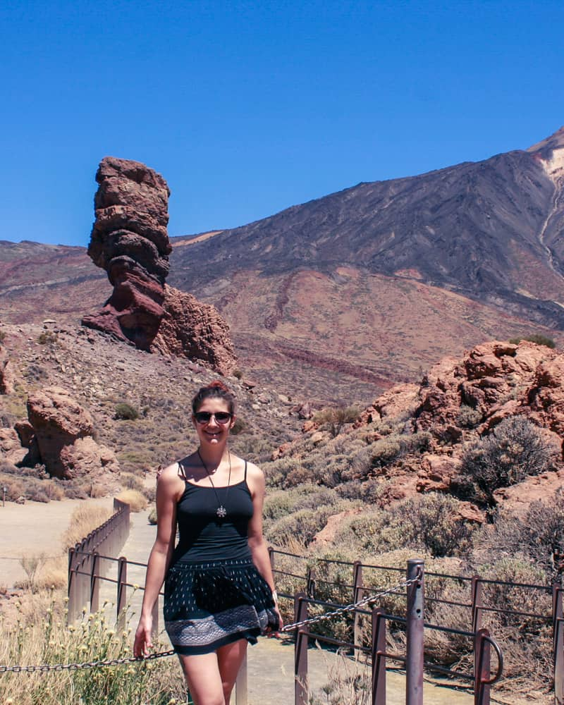 A girl in front of rock formations Los Roques de Garcia and the Volcano El Teide in Tenerife, Canary Islands, Spain