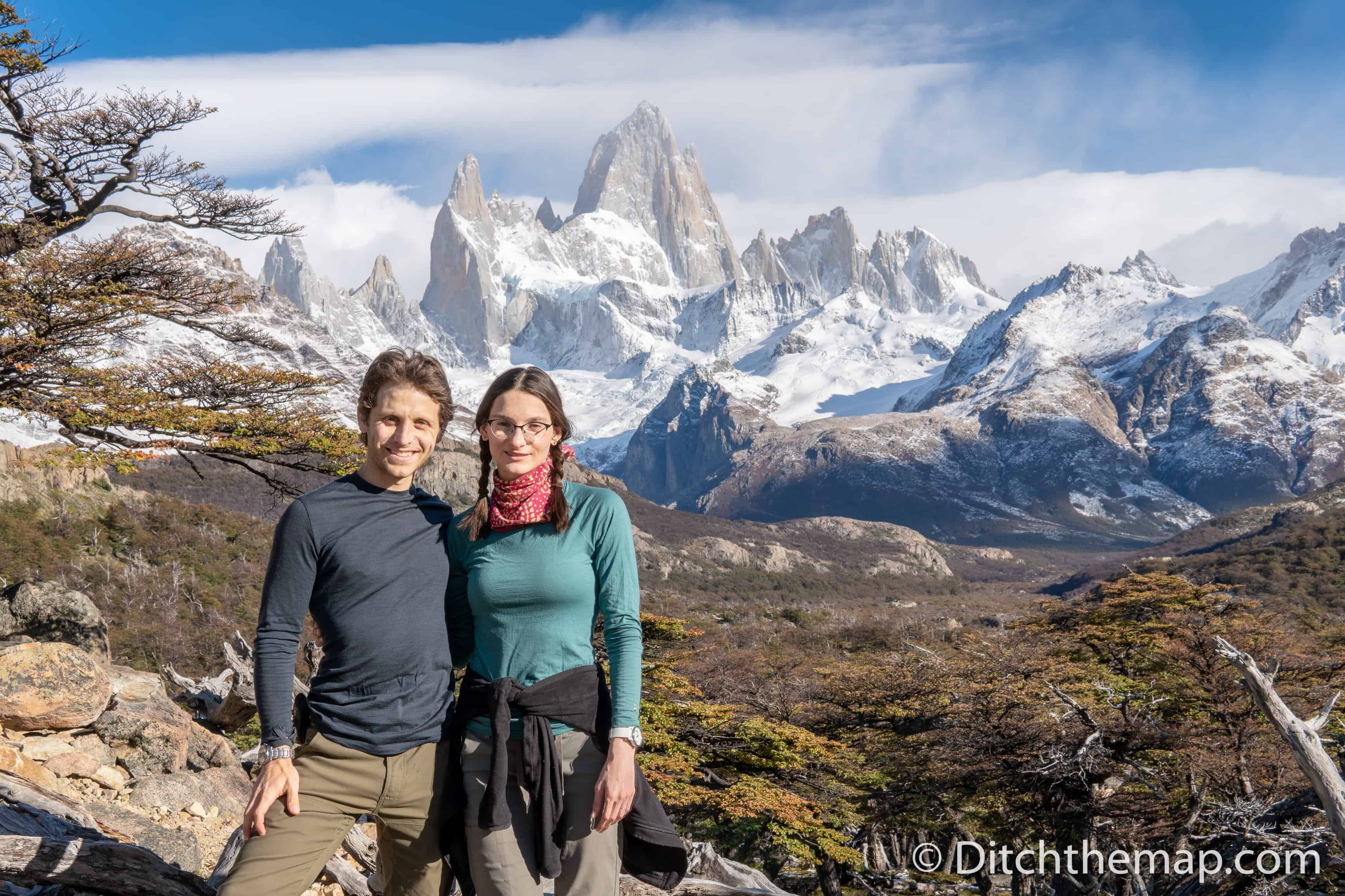 A couple hiking on a snowy mountain Fitz Roy in El Chalten