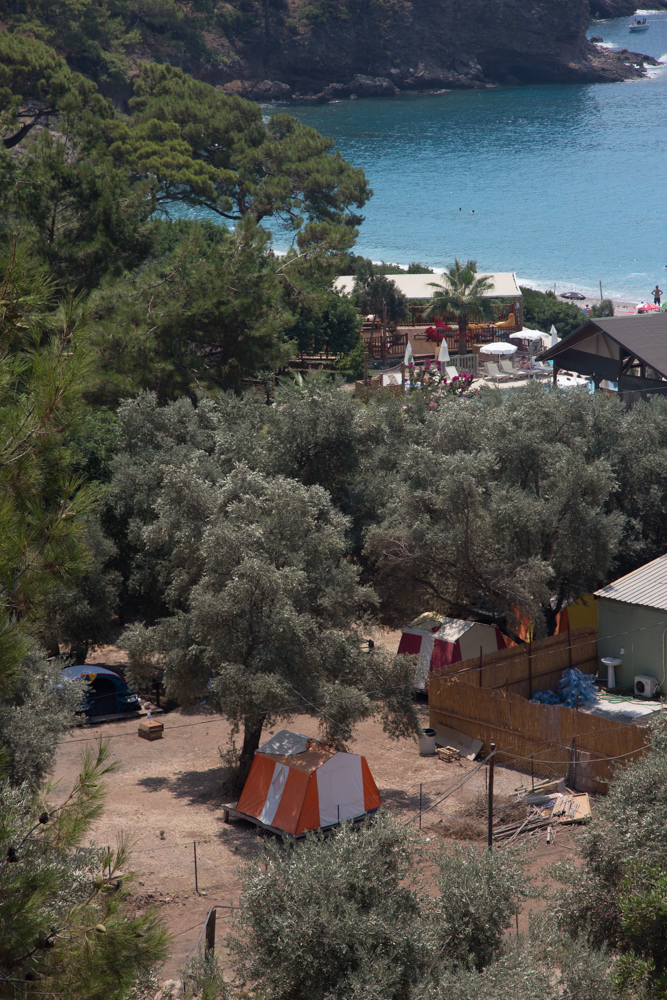 Kabak Koyu seen from the walk down from Sultan's Camp. Tents, beach and trees.